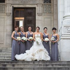 I'm loving how well the grey bridesmaid's dresses compliment the bride's gown! (Photography: Roey Yohai Photography)