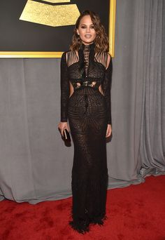 BEST: Slay! Chrissy Teigen flauntedher supermodel body in a black cutout gown that showed a hint of flesh. (Photo by Alberto E. Rodriguez/Getty Images for NARAS)  via @AOL_Lifestyle Read more: https://www.aol.com/article/entertainment/2017/02/12/grammy-awards-2017-best-and-worst-dressed/21712482/?a_dgi=aolshare_pinterest#fullscreen