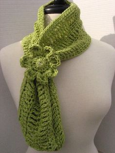 Pattern for a very cute scarf, the flower is on a band that you slide up on the scarf to hold it in place... $3.99
