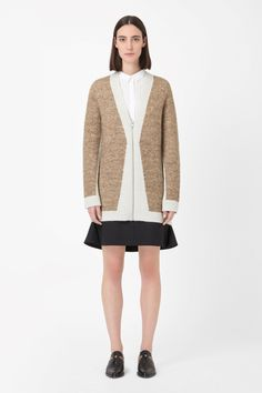 Made from a blend of wool and mohair with a soft brushed finish, this long cardigan has a modern block-coloured design. Straight in the body, it has a deep v-neckline, zip-up fastening and a deep v-neckline.