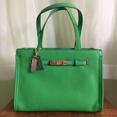 Coach swagger green pebble leather Brand new/ never used. NWT. Very vibrant green, makes a great pop of color to any outfit, a closet stable. Measurements approx 12in x9in. Strap drop length approx 8in. ☘☘☘☘☘☘☘☘☘Comes with dust bag and Coach card. Style #34915 Coach Bags
