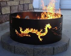 Stunning Backyard Metal Dragon Fire Pit Designs Gather around a crackling fire with the top 60 bets metal fire pit ideas. Explore unique steel, copper and iron backyard designs from round to rectangular. Wood Fire Pit, Diy Fire Pit, Fire Pit Backyard, Metal Fire Pit Ring, Backyard Seating, Dragon Fire Pit, Design Dragon, Dragons, Outdoor Fire