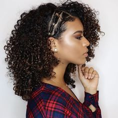 Woman with curly hair and side swept twists