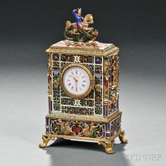 Continental Gilt-metal and Enamel Table Clock, 19th/20th century, the rectangular shape with St. George and the Dragon finial, circular face, either side with a full-relief soldier.