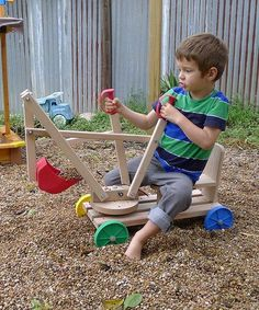 Little ones will love digging around in the sandbox or rocks in the yard on this delicately crafted excavator set made of natural Austrian hardwood beech.