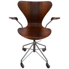 Rare Arne Jacobsen Rosewood Swivel Desk Chair with Arms | See more antique and modern Office Chairs and Desk Chairs at https://www.1stdibs.com/furniture/seating/office-chairs-desk-chairs