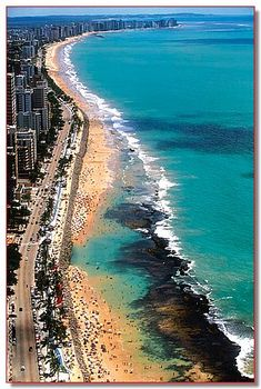 Recife, Brasil - Boa Viagem beach. The dark area is a line of reefs (in Portuguese, 'recifes') which protect the shore. When tide lowers, natural swimming pools are formed.