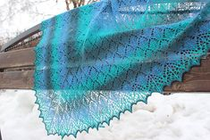 The Sea Speaks To Me shawl by Athanasia Andritsou. It's easy to knit and based on an Estonian stitch.  And the pattern is FREE on Ravelry.