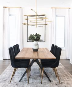 neutral dining room design, modern dining room design with modern gold chandelier and black upholstered dining room chairs and mid century modern dining room table Home Interior, Interior Design Living Room, Living Room Decor, Design Interiors, Decor Room, Room Art, Small Dining, Dining Set, Black Dining Room Chairs