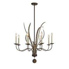 This 8 Light Candle Chandelier has a nature-inspired look with metal ribbon details that blossom forth from the column, perfectly complementing the pale cream candle covers and fiesta bronze finish. Can be mounted on a sloped ceiling.