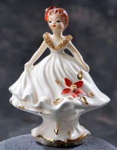 """Vintage """"JOSEF ORIGINALS"""" Ceramic figurine in Christmas poinsettia dress."""