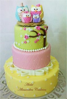 3 Tiered Owl Cake with Yellow & Rosettes, Pink Embossed Diamonds and Lime with Pink & White Blossoms and Topped with Owl Family of 4.