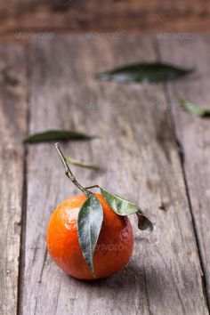 Tangerine with leaves on wooden background misc Catering Logo, Group Health, Food Fresh, Wooden Background, White Wood, Agriculture, Juice, Vitamins, Vegetarian