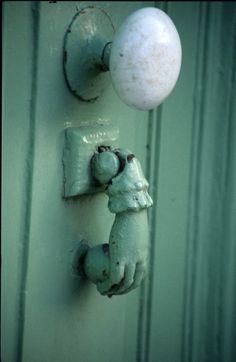 hand door knocker with milk glass door knob