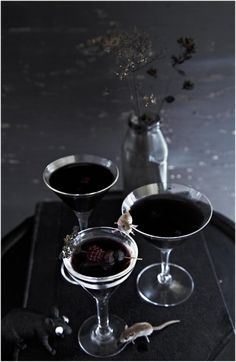 El Diablo Martini in time for Halloween. Ingredients: Vodka  1 oz dry vermouth  1.5 oz creme de cassis  A few fresh blackberries  Shake in shaker and pour into ice-cold martini glass. Garnish with blackberries.