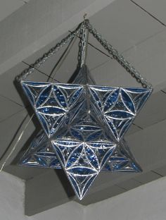 Merkaba (star tetrahedron) stained glass lamp with Flower of Life pattern.  Sacred geometry!