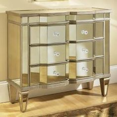 For a unique but practical accent to a contemporary room, this mirrored accent chest stands out. Three functional drawers provide extra storage options for a variety of spaces including living rooms a