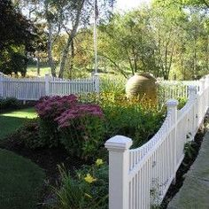 I've always appreciated a white picket fence...  But really, the huge garden vase is what sold me.
