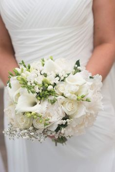 Beautiful Lisas Bouquet of White Roses, White Peonies, White Bouvardia, Freesia, Calla Lilies and Babys Breath. I love this bouquet. Photo by Hennessy Photography Ltd.