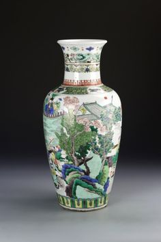 China, Kangxi Period, Wucai vase, high shouldered body, with flared rim, white ground, with brightly painted battle scene motif on body, double ring mark. Height 18 in.