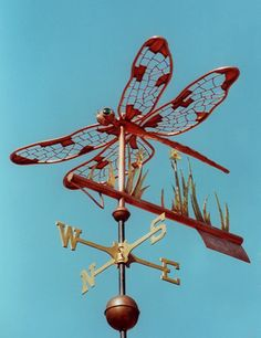 The Dragonfly Weather Vane, Odonata Anisoptera, consists of an all copper dragonfly & arrow w/ brass reeds & gold leafed marsh flowers. Custom design available.