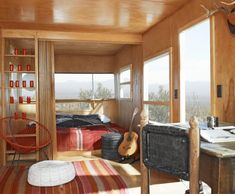 love...  The Imperial Mansion, a Spartan trailer from the 1950s, consists of a living room, dining area, galley kitchen, bathroom, and second bathroom elegantly shoehorned into 323 square feet.