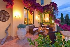 Mediterranean Patio with Tuscan wrought iron metal wall grille plaque, Wicker  outdoor set, exterior tile floors, Balcony