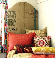 """Make Your Own Headboard  Mix and match. The designers constructed a tall headboard from old grain sacks to add interest and elevate the eye. Burlap fabric wrapped and stapled onto sturdy insulation sheathing makes an earthy, bohemian statement and contrasts the room's sterile feel. """"The curvilinear headboard balances the room's hard lines and sharp appearance."""