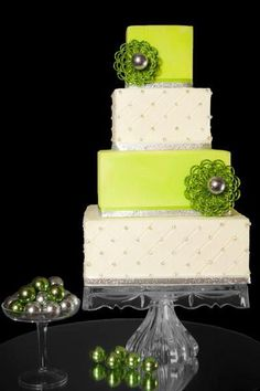 Layer wedding cake.  Square tiers in white and lime green.  Fresh and pretty:-)