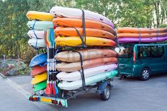 """Buy the royalty-free Stock image """"Car with trailer with kayaks and paddles"""" online ✓ All image rights included ✓ High resolution picture for print, web . Lawn Trailer, Kayak Trailer, Trailer Plans, Kayak Rack, Kayak Storage, Racing Quotes, Kayak Rentals, Small Trailer"""