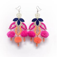 These gorgeous earrings are an instant statement for a classic white oxford or your favorite little black dress. Get ready for endless amounts of compliments. Our Pom Pom Earrings with Navy and Gold detail. Orange and Pink pom poms and beads.