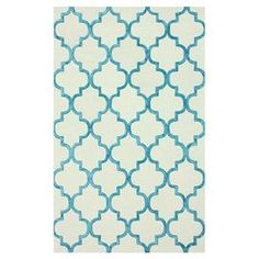 Hand-tufted wool-blend rug with a Moroccan-inspired motif.   Product: RugConstruction Material: Wool and viscoseColor: TurquoiseFeatures:  Hand-tuftedMade in India Note: Please be aware that actual colors may vary from those shown on your screen. Accent rugs may also not show the entire pattern that the corresponding area rugs have.Cleaning and Care: These rugs can be spot treated with a mild detergent and water. Professional cleaning is recommended if necessary.