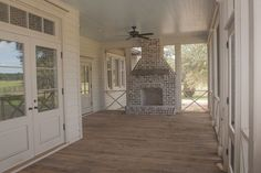 Love the light color, screened porch, fan, tramsim windows above doors but move fireplace to house wall and share chimney with interior fireplace. Brays Island Plantation