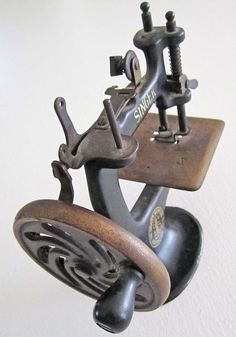 What a cute little vintage Singer sewing machine, but boy how far we have come!
