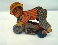 CHAD VALLEY CLOCKWORK TOY  BLACK MAN/NEGRO  ON MOTORCYCLE.WIND UP.