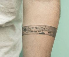 Thailand inspired hand poked armband tattoo on the left forearm. Tattoo Artist…
