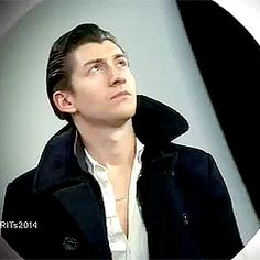 Alex Turner punches the air/airfist gif