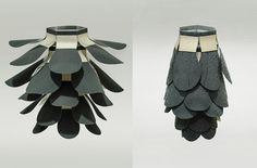 A biomimetic copy of a pine cone by Chao Chen, an industrial design student. It has been created by using a bi-layered laminate that react to water just like a pine cone. It is dry in its natural state (left) and closes when wet. There are endless practical uses for this nature inspired low impact technology
