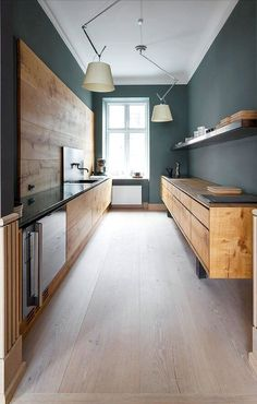 5 Colours Scientifically Proven to Change the Mood of Your Home [Infographic] Modern-dark-green-kitchen