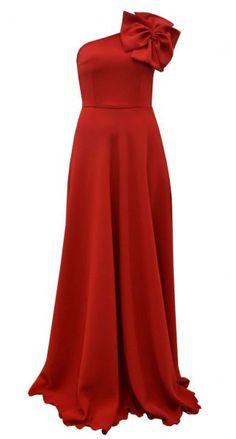Vestido de fiesta asimétrico largo rojo con adorno en el hombro. Para las invitadas a bodas amantes de este alegre color.