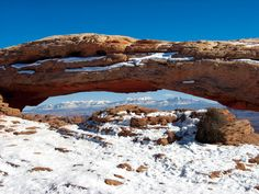 The La Sal Mountains viewed through Mesa Arch in the Island in the Sky District of Canyonlands National Park –  Photographer: Taylor Boden