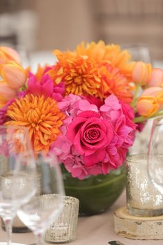 Hot pink + orange flower centerpieces - roses, hydrangeas, tulips, and dahlias {Pepper Nix Photography}