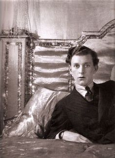 Poet Stephen Tennant in his Syrie Maugham designed all white satin bed.  I think he spent a lot of time in it.