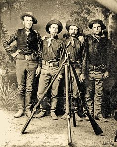 Adding firepower to their hard hitting, .45-70 caliber rifles (stacked in the foreground), these infantrymen secured .45 caliber Colt revolvers as they set off to face Apaches in the Southwest during the 1880s. During their frontier service, many faced an evolution of firearms that contributed to new tactics of warfare, at a time when most troops didn't even receive basic training before they were sent to their far-flung posts.  – Courtesy Glenn Swanson Collection –