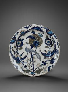 Plat au paon, Turquie, Iznik, vers 1550, céramique siliceuse, décor peint sous glaçure  Musée du Louvre