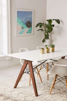 The Saints Dining Table is a sleek Mid-Century Modern dining table perfect for an intimate dinner or lunch setting. Paired with our Truman Chair in White, this dining combo is a fantastic small space solution for any modern home!