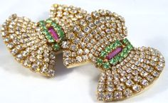 Beautiful Vintage Bow Rhinestone Clip-On Earrings - This pair of vintage rhinestone earrings are stunning. They are clip on and a beautiful addition to any jewelry collection! https://www.etsy.com/listing/173002115/beautiful-vintage-bow-rhinestone-clip-on?ref=related-6