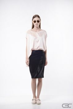http://cbcdesign.ro/en/shop/fusta-black-skin/ Conical-shaped skirt with eco leather insertion on the front of the product and on its waistband. Through styling, the skirt can be transformed in different styles: office accessorized with nude stilettos, grunge with some colored boots or chic with a delicate top. The wearing options are unlimited when it comes to a body-hugging black skirt. Product also available in rose.