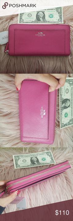 Coach zipper wallet NWT Nwt coach wallet Stunning color fuchsia  100% authentic. I'm not a fan of replica 👎 Retail price 318 plus tax. I have to see this beauty go but it's just sitting on my closet Coach Bags Wallets