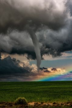 A Tornado in Front of a Rainbow - A beautiful shot of a tornado forming in front of a rainbow. This was a rare meteorological event witnessed near Lamar, CO. Photography by  Jason Vanstry